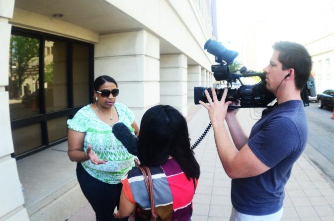 Juanita Ridge talks with KAKE reporters outside DCF.