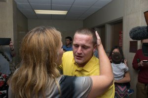 Kyler Carriker embraces his mother, immediately following his acquittal on the charge of felony murder