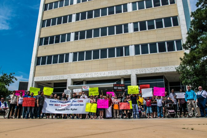 Roughly 100 people from Kansas, Illinois, and California protest in support of Kyler Carriker.