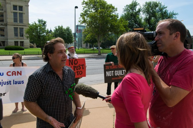 California activist Joe Grumbine, being interviewed by KAKE News outside of the courthouse during Carriker's trial.